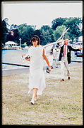 Henley. England, 1989 Henley Royal Regatta, River Thames, Henley Reach,  [© Peter Spurrier/Intersport Images],  Moving a single scull out of the boat tent area [Ian WATSON]