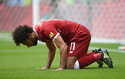Liverpool's Mohamed Salah celebrates scoring his side's third goal during the Premier League match at Vicarage Road, Watford.