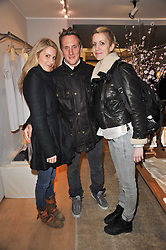 Left to right, LADY KINVARA BALFOUR, HARRY BECHER and LADY CANDIDA BALFOUR at the launch party for Club Monaco at Browns, 32 South Molton Street, London on 16th February 2011.