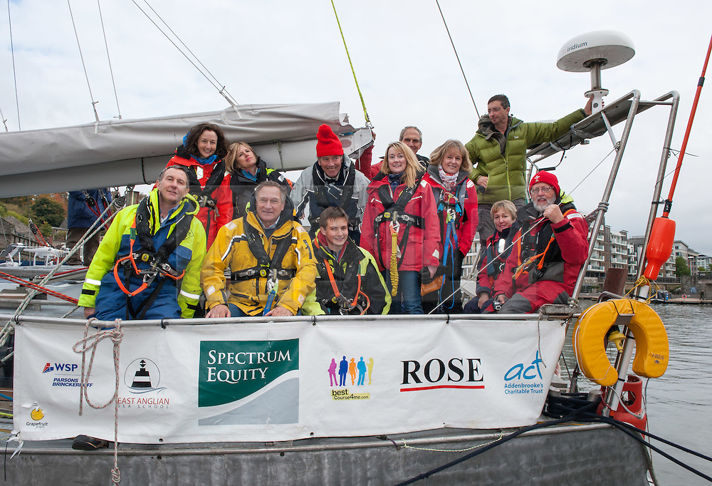 © Licensed to London News Pictures. 20/10/2016. Bristol, UK. Explorer David Hempleman-Adams (yellow sailing jacket) with Ben Edwards (age 14 from Cambridge) and crew arrive back in Bristol docks after their Arctic voyage, after becoming the first British crew to circumnavigate the North Pole in a single season. They left Bristol in June onboard the polar exploration yacht Northabout and completed the 14,000 miles (22,500km) voyage through the Northeast and Northwest passages in just four months.<br /> The challenge has only recently become possible due to retreating sea ice. Photo credit : Simon Chapman/LNP