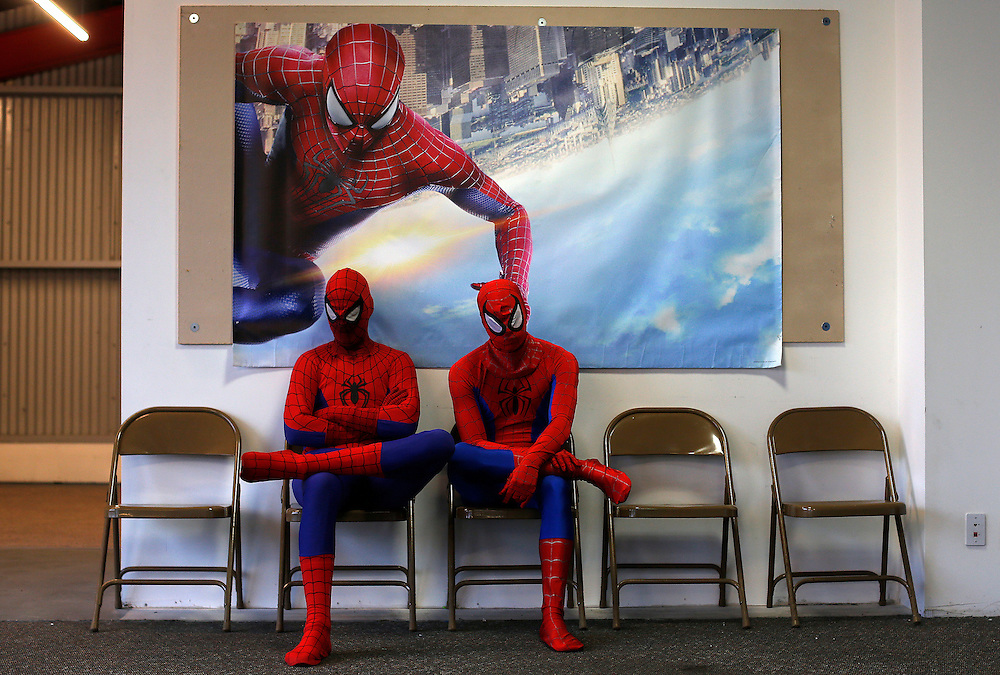 """Peter Norbot (L) and Kris Hamilton, dressed up as fictional comic book superhero Spider-Man, wait for their turn to audition to be a part of a promotional campaign for the upcoming release of the new movie """"The Amazing Spider-Man 2"""" in Chicago March 19, 2014.   REUTERS/Jim Young"""