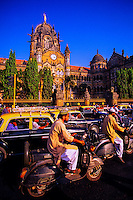 Street traffic in front of Victoria Terminus (railroad station), Mumbai (Bombay), Maharashtra, India