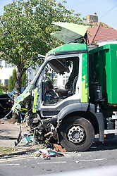 ©Licensed to London News Pictures 14/09/2020  <br /> Kidbrooke, UK. The lorry at the scene of the crash. A bin lorry has crashed into multiple cars and a house in Kidbrooke, South East London. A number of people have been injured police, fire and ambulance are all on scene. credit:Grant Falvey/LNP