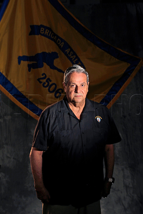 """FELIX RODRIGUEZ, 69<br /> Infiltration team<br /> From his safe house inside Cuba, Felix Rodriguez remembers the shock at seeing <br /> television reports of the the camouflaged Bay of Pigs invaders being rounded up, <br /> hands behind their heads.<br /> Rodriguez, the current president of Assault Brigade 2506, had been smuggled into <br /> Cuba weeks earlier and had been supplying the underground movement with arms and <br /> equipment -- waiting for orders to join the fight to topple Fidel Castro's <br /> government soon after the invasion was launched.<br />  """"The Americans never informed us the invasion was on its way; I was caught by <br /> surprise,'' he said. Instead, Rodriguez said Castro launched a massive crackdown <br /> across the country.<br />  """"They began rounding up everybody suspected of being part of the opposition. <br /> There were as many as 100,000 activists held in sports stadiums and inside the <br /> famous Blanquita Theater.''<br />  Rodriguez found himself trapped with no way out of Cuba.<br />  """"I would call people on the phone who had been working with me and no one would <br /> answer. Or someone would answer and encourage me to come right over -- a trap.''<br />  After several tense days, a Cuban woman working with the Brigade infiltrators <br /> helped him get to the Venezuelan embassy in Havana, where he sought political <br /> asylum. """"If it wasn't for her, I would have been caught and killed,'' he said.<br />  """"The invasion was a total disaster.''Bay of Pigs veteran,  Felix Rodriguez poses at the Bay of Pigs Museum in Little Havana. He is a member of the Bay of Pigs Veterans Association, Brigade 2506"""