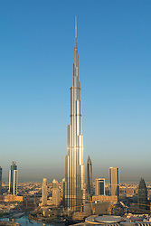 Burj Khalifa and skyline of Downtown Dubai at sunrise in United Arab Emirates