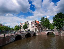 Canal and old bridges in Amsterdam The Netherlands