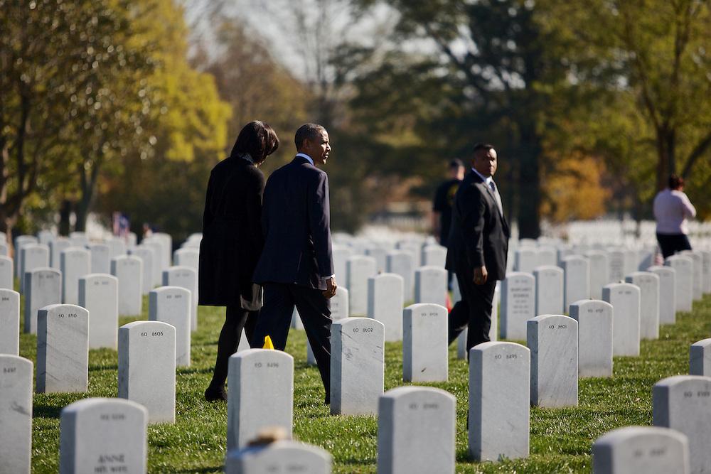 ARLINGTON, VA - NOVEMBER 11: U.S. President Barack Obama and first lady Michelle walk through Arlington National Cemetery after greeting family members of fallen service men and women on Veteran's Day November 11, 2012 in Arlington, Virginia.