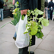 Buying vegetables at Edinburgh farmers market, Scotland