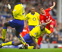 Photo. Jed Wee.<br /> Liverpool v Arsenal, FA Barclaycard Premiership, Anfield, Liverpool. 04/10/03.<br /> Liverpool's Harry Kewell (R) scores one but misses a couple of good chances.