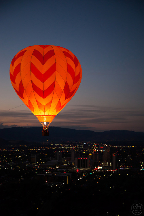 """""""Dawn Patrol 16"""" - Photograph of a glowing hot air balloon flying for the Dawn Patrol at the 2012 Great Reno Balloon Race. Photographed from a hot air balloon."""