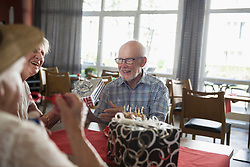 Senior man and women celebrating birthday at rest home, Bavaria, Germany, Europe