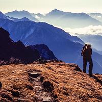 A trekker croses a pass betwen the Hinku and Khumbu Valleys in the Khumbu region of Nepal. 1980.