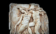 Roman Sebasteion relief sculpture of Achilles and a dying Amazon, Aphrodisias Museum, Aphrodisias, Turkey.   Against a black background.  <br /> <br /> Achilles supports the dying Amazon queen Penthesilea whom he has mortally wounded. Her double headed axe slips from her hands. The queen had come to fight against the Greeks in the Trojan war and Achilles fell in love with her. .<br /> <br /> If you prefer to buy from our ALAMY STOCK LIBRARY page at https://www.alamy.com/portfolio/paul-williams-funkystock/greco-roman-sculptures.html . Type -    Aphrodisias     - into LOWER SEARCH WITHIN GALLERY box - Refine search by adding a subject, place, background colour, museum etc.<br /> <br /> Visit our ROMAN WORLD PHOTO COLLECTIONS for more photos to download or buy as wall art prints https://funkystock.photoshelter.com/gallery-collection/The-Romans-Art-Artefacts-Antiquities-Historic-Sites-Pictures-Images/C0000r2uLJJo9_s0