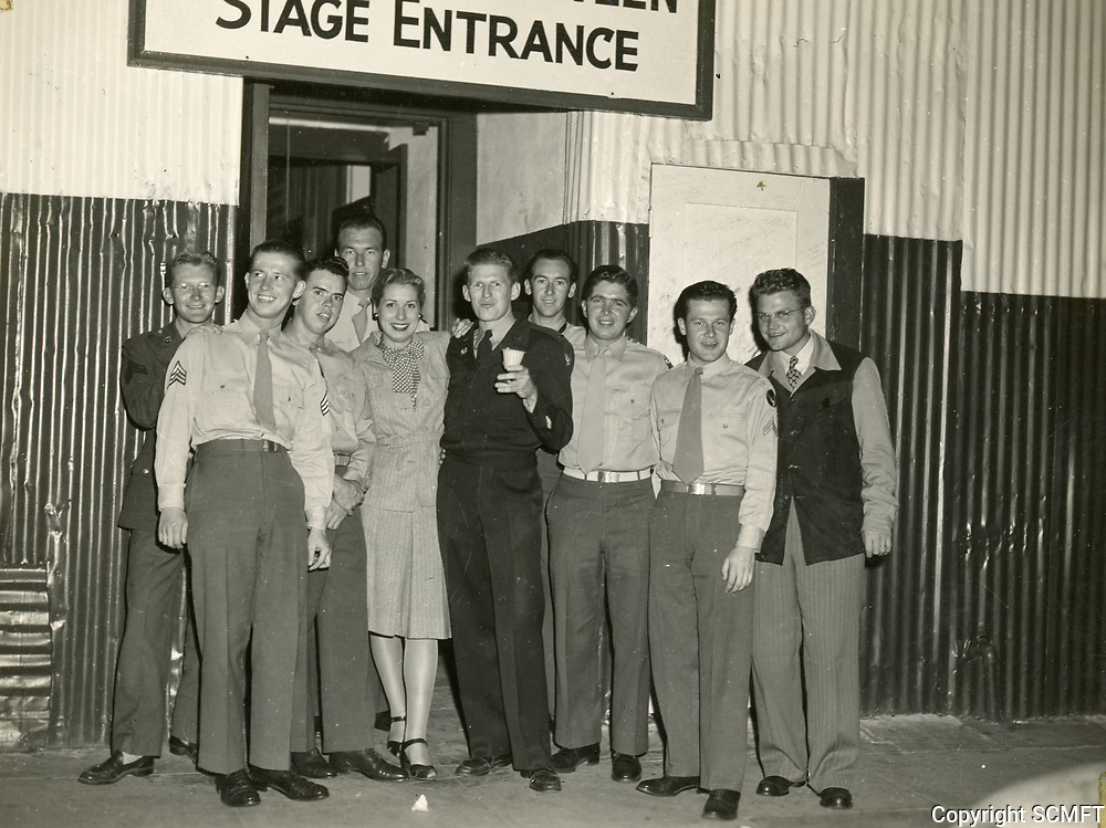 11/22/45 Most of the 684th AAF Band members pose at the Hollywood Canteen's Stage entrance. Bandleader, Alexander Courage in center with cup; saxophone player, Earl Kinney is behind Courage, & to the right