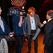 NLD/Rotterdam/20130204 - Premiere LULverhalen 2013, Hans Kazan word geinterviewd door omroep Max