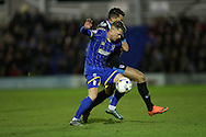 AFC Wimbledon midfielder Jake Reeves (8) and Portsmouth midfielder Gareth Evans (26) during the Sky Bet League 2 match between AFC Wimbledon and Portsmouth at the Cherry Red Records Stadium, Kingston, England on 26 April 2016.