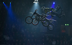 © licensed to London News Pictures. London, UK 14/03/2012. Two motorbike riders performing a stunt during the Masters of Dirt show at Wembley Arena in London on March 14th, 2012. The Masters of Dirt show features top European freestyle riders performing some stunts on motocross motorcycles, along with a host of other machines including minibikes and quads. Photo credit: Tolga Akmen/LNP