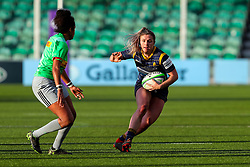 Hannah Bluck of Worcester Warriors Women tries to evade the challenge of Lagi Tuima of Harlequins Women - Mandatory by-line: Nick Browning/JMP - 20/12/2020 - RUGBY - Sixways Stadium - Worcester, England - Worcester Warriors Women v Harlequins Women - Allianz Premier 15s