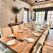 The interior of Virtue Feed and Grain, a restaurant and tavern in Old Town Alexandria, Virginia. The restaurant is located in a renovated historic building that once served as a feed and grain warehouse.