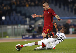 December 5, 2017 - Rome, Italy - Roma s Radja Nainggolan, left, is tackled by Qarabag s Donald Guerrier during the Champions League Group C soccer match between Roma and Qarabag at the Olympic stadium. Roma won 1-0 to reach the round of 16. (Credit Image: © Riccardo De Luca/Pacific Press via ZUMA Wire)