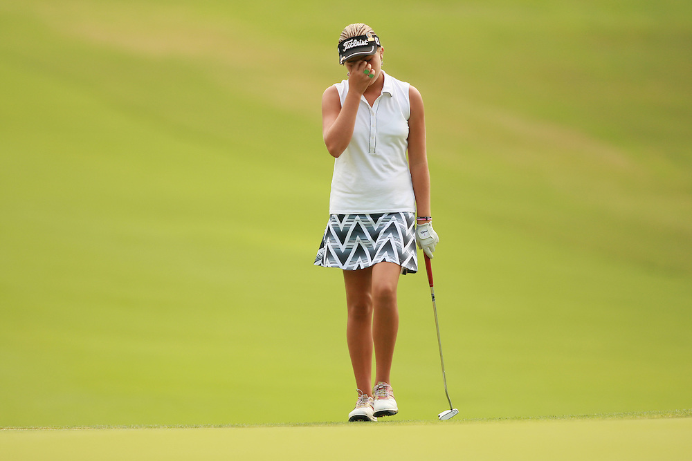 SOUTHERN PINES, NC - JUNE 30:  Alexis Thompson reacts to a missed putt during the second round of the 2007 U.S. Women's Open Championship in Southern Pines, North Carolina at Pine Needles Lodge and Golf Club on Saturday, June 30, 2007. (Photo by Darren Carroll/Getty Images) *** LOCAL CAPTION *** Alexis Thompson