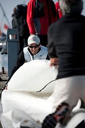 Mathieu Richard flaking the main sail. Danish Open 2010, Bornholm, Denmark. World Match Racing Tour. photo: Loris von Siebenthal - WMRT