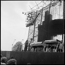 The Grateful Dead Concert at Dillon Stadium on 31 July 1974. Shot this photo at the very beginning of the first set. I think someone bumped my elbow when the shutter clicked, this shot is a bit skewed. B&W Original Film Scan. Photograph taken with a Hasselblad Camera with Tri-X film. This photograph can be straightened and cropped though I wish to show the full camera capture of all 12 of these medium format photos.
