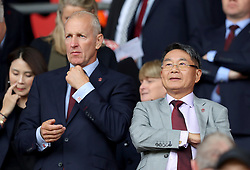 """Southampton chairman Ralph Krueger (left) with owner Gao Jisheng in the stands before the Premier League match at St Mary's, Southampton. PRESS ASSOCIATION Photo. Picture date: Sunday August 12, 2018. See PA story SOCCER Southampton. Photo credit should read: Andrew Matthews/PA Wire. RESTRICTIONS: EDITORIAL USE ONLY No use with unauthorised audio, video, data, fixture lists, club/league logos or """"live"""" services. Online in-match use limited to 120 images, no video emulation. No use in betting, games or single club/league/player publications."""