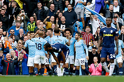 Manchester City's Leroy Sane (third right) celebrates scoring his side's first goal of the game during the Premier League match at the Etihad Stadium, Manchester.
