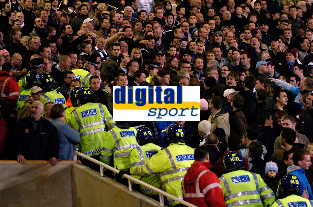 Photo: Ed Godden.<br /> West Ham United v Manchester United. The Barclays Premiership. 17/12/2006. The Police make their way into the West Ham fans stand.