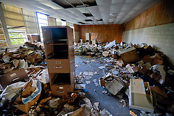 23 August 2013. Braithwaite, Louisiana.<br /> Hurricane Isaac 1 year later. <br /> The eerie remains of Woodlawn School. The crumbling classic art deco school was heavily damaged by the storm and remains full of debris. <br /> Photo; Charlie Varley