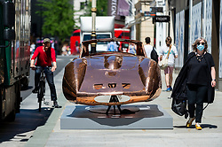 """© Licensed to London News Pictures. 01/06/2021. LONDON, UK. """"Ferrari 250 GTO"""", 2021, by Anthony James, a copper chassis in New Bond Street, one of 22 public outdoor sculptures installed as part of this year's Mayfair Sculpture Trail and can be seen around Mayfair 2 to 27 June.  The sculpture trail forms part of the eighth, annual edition of Mayfair Art Weekend which celebrates the rich cultural heritage of Mayfair as one of the most internationally known, thriving art hubs in the world with free exhibitions, tours, talks and site-specific installations available to the public.  Photo credit: Stephen Chung/LNP"""
