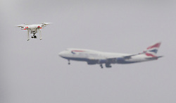 © Licensed to London News Pictures. 28/02/2017. London, UK. A DJI Phantom drone is seen in sight of a British Airways passenger plane . The plane is three miles away on approach to London Heathrow. Photo credit: Peter Macdiarmid/LNP
