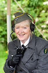 reenactor dressed as German army female signals auxiliary (Nachrichtenheflrennin des heeres) also nicknamed Blitzmädchen or lightening girls because of the signals insignia on their uniforms. <br /> Stanhope War on the line Weardale Railway Co Durham<br /> 14 July 2012<br /> Image © Paul David Drabble
