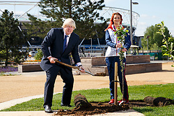© Licensed to London News Pictures. 26/05/2015. London, UK. The Mayor of London, Boris Johnson and Paralympic gold medallist Jessica Jane Applegate mark London Tree Week by planting the final tree in the new Mandeville Place Orchard in Queen Elizabeth Olympic Park on Tuesday 26 May 2015. Photo credit : Tolga Akmen/LNP