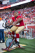 San Francisco 49ers offensive guard Joshua Garnett (65) watches a preseason game against the Houston Texans from a stationary bike on the sideline at Levi's Stadium in Santa Clara, Calif., on August 14, 2016. (Stan Olszewski/Special to S.F. Examiner)