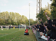 Fans cheer as DHFC score a goal during Dulwich Hamlet FC vs Burgess Hill Town F.C. at Champion Hill on 21st October 2017 in South London in the United Kingdom. Dulwich Hamlet was founded in 1893 and both teams play in the Isthmian League Premier Division, a regional mens football league covering London, East and South East England.