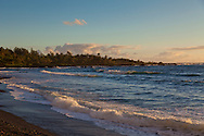 Maui, Hawaii.  The beach in Hana as seen from the Bamboo Inn.  Here the beach is made of black cobblestones and is divided from the other beach in Hana by a lava outcropping.
