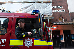 © Licensed to London News Pictures.20/11/2013. London, UK. Fire brigade arrive at the Apollo Theatre. Seventy-sixpeople injured, seven seriously hurt after the roof of the Apollo collapsed yesterday, on the 19th of December.Photo credit : Peter Kollanyi/LNP