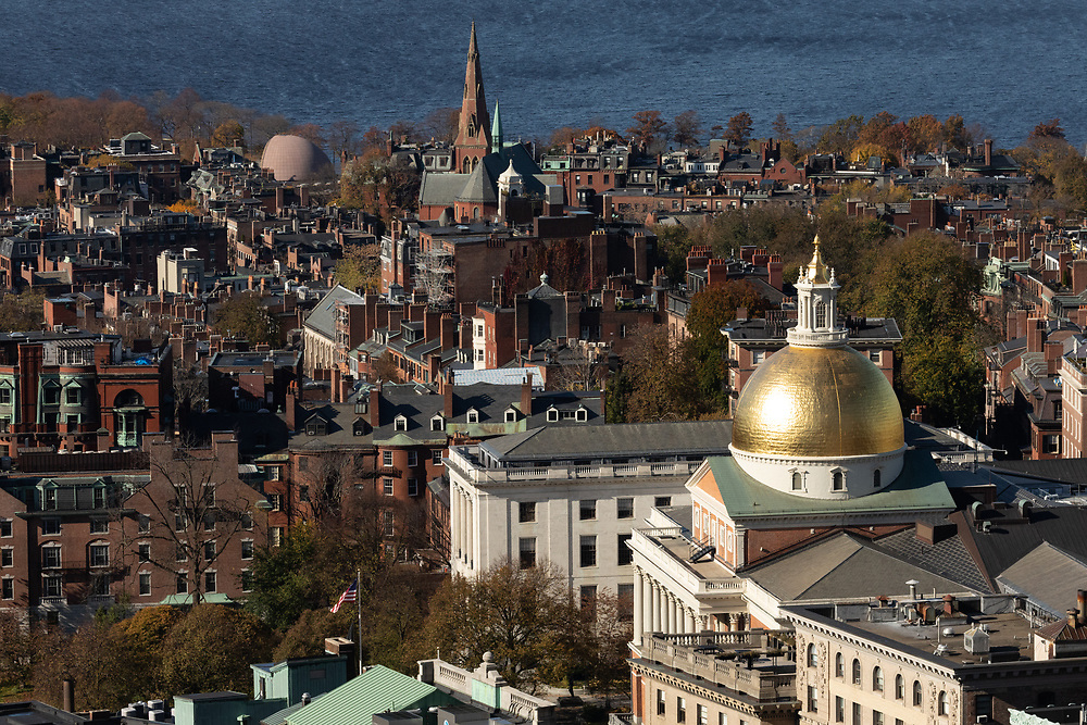 The Massachusetts State House seen from Downtown on a cold autumn morning.