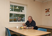 A male lorry driver eats dinner at Cartgate Services, a 24hour roadside transport cafe and service area, on the 02nd June 2008 in Yeovil, England in the United Kingdom.
