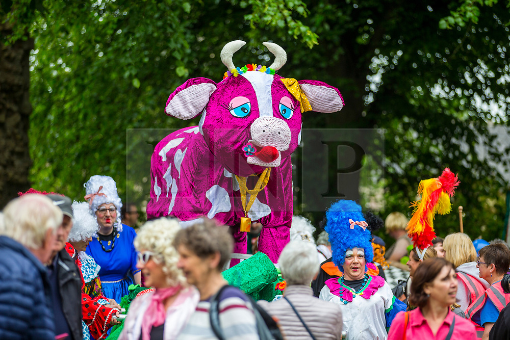 © Licensed to London News Pictures. 09/06/2018. Knaresborough UK. Fancy dress bed's arrive at the Knarsborough bed race today. Knaresborough bed race is taking place today in the town of Knaresborough in Yorkshire. The race first held in 1966 is part fancy dress & part gruelling time trial over a 2.4 mile course ending with a swim through the River Nidd. Photo credit: Andrew McCaren/LNP