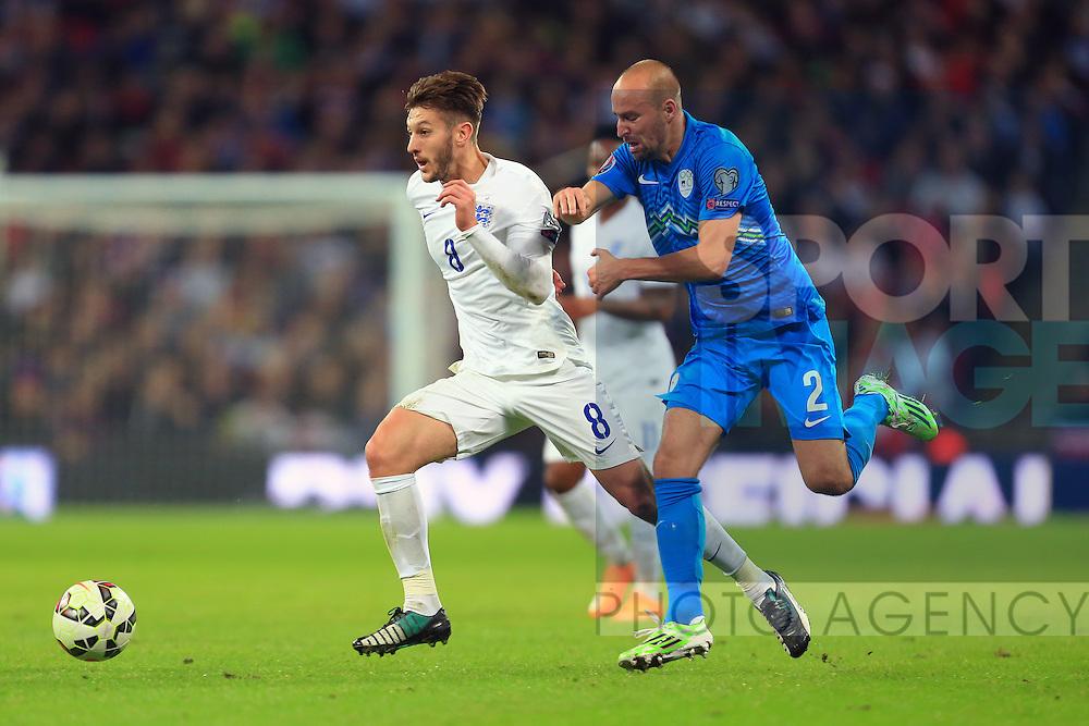 Adam Lallana of England battles Miso Brecko of Slovenia - England vs. Slovenia - UEFA Euro 2016 Qualifying - Wembley Stadium - London - 15/11/2014 Pic Philip Oldham/Sportimage