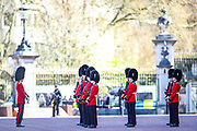 The Queen's Guards perform the minute silence salute outside Buckingham Palace in central London on Saturday, April 17, 2021, during the funeral of Prince Philip of the United Kingdom. The Queen announced the death of her beloved husband, His Royal Highness Prince Philip, Duke of Edinburgh who died at age 99. HRH passed away peacefully on April 9th at Windsor Castle after 73 years of marriage to Britain's Queen Elizabeth II. (Photo/ Vudi Xhymshiti)