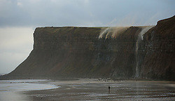 © Licensed to London News Pictures. 28/11/2012..Huntcliff, Saltburn, England..Rainwater from the recent heavy rain runs off Huntcliff in Saltburn and is blown back over the edge by strong Northerly winds...Photo credit : Ian Forsyth/LNP