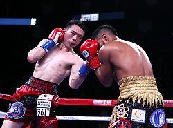 HOUSTON, Jan. 27, 2019  Xu Can (L) of China competes during the competition with Jesus Rojas in Houston, the United States, on Jan. 26, 2019. Xu Can lifted China's first ever World Boxing Association title here on Saturday after he defeated defending champion Jesus Rojas of Puerto Rico by unanimous decision. (Credit Image: © Steven Song/Xinhua via ZUMA Wire)