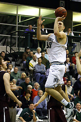 16 December 2006: Zach Freeman one hands a shot in the lane. The University of Chicago Maroons upset  the Illinois Wesleyan Titans 64 - 60 at the Shirk Center in Bloomington Illinois.<br />