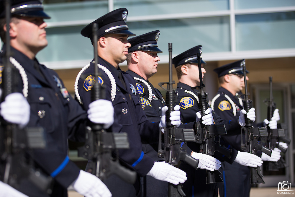 Members of the Milpitas Police Officers Association perform a 21-Gun Salute during the Memorial Day Ceremony at Milpitas City Hall's Veterans Plaza in Milpitas, California, on May 26, 2014. (Stan Olszewski/SOSKIphoto)