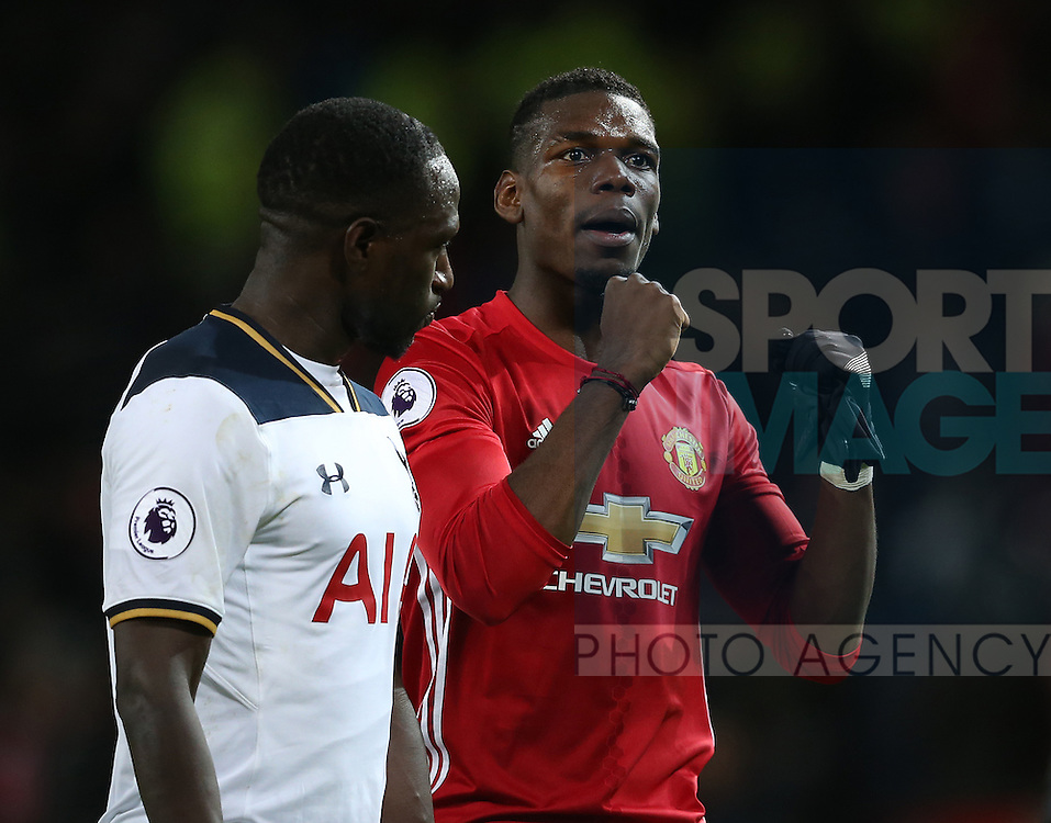 Paul Pogba of Manchester United celebrates the win alongside Moussa Sissoko of Tottenham during the English Premier League match at Old Trafford Stadium, Manchester. Picture date: December 11th, 2016. Pic Simon Bellis/Sportimage