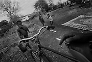 Little village Guingon, children playing with bikes.